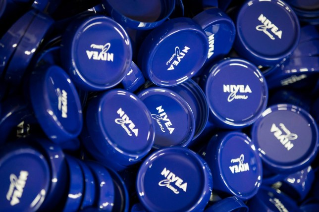 18 April 2018, Germany, Hamburg:?Plastic lids for Nivea-Creme in a storage container at the production plant of the German personal-care company Beiersdorf. Photo: Christian Charisius/dpa