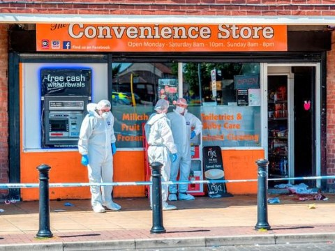 Man stabbed to death outside row of shops at lunchtime