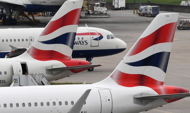 British Airways aircraft stand on their parking positions at Heathrow Airport in London, Britain
