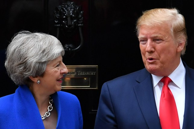 "(FILES) In this file photo taken on June 4, 2019 Britain's Prime Minister Theresa May (L) speaks with US President Donald Trump (R) and she greets him outside 10 Downing Street in London on the second day of the US president's three-day State Visit to the UK. - President Donald Trump assailed Britain's US ambassador as a ""pompous fool"" and slammed outgoing premier Theresa May's ""foolish"" policies in a second straight day of virulent attacks triggered by the leak of unflattering diplomatic cables. The missives threaten to plunge Washington and London into an unprecedented diplomatic crisis with uncertain outcome, and have landed their author, British Ambassador Kim Darroch -- and by default his prime minister -- in Trump's crosshairs.""The wacky Ambassador that the UK foisted upon the United States is not someone we are thrilled with, a very stupid guy,"" Trump tweeted July 9, 2019, mirroring a furious barrage of insults the day before. (Photo by Ben STANSALL / AFP)BEN STANSALL/AFP/Getty Images"