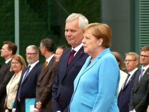 Angela Merkel insists she's 'fine' after being filmed shaking for third time