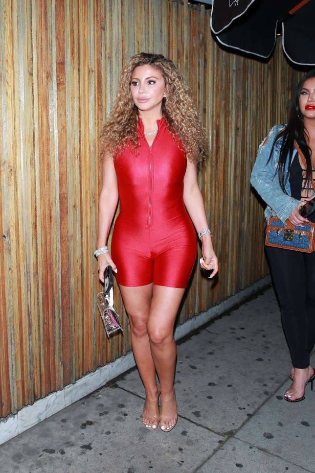 West Hollywood, CA - Larsa Pippen shows off her figure in a red spandex jumpsuit for a night out at The Nice Guy. Pictured: Larsa Pippen BACKGRID USA 10 JULY 2019 BYLINE MUST READ: NGRE / BACKGRID USA: +1 310 798 9111 / usasales@backgrid.com UK: +44 208 344 2007 / uksales@backgrid.com *UK Clients - Pictures Containing Children Please Pixelate Face Prior To Publication*