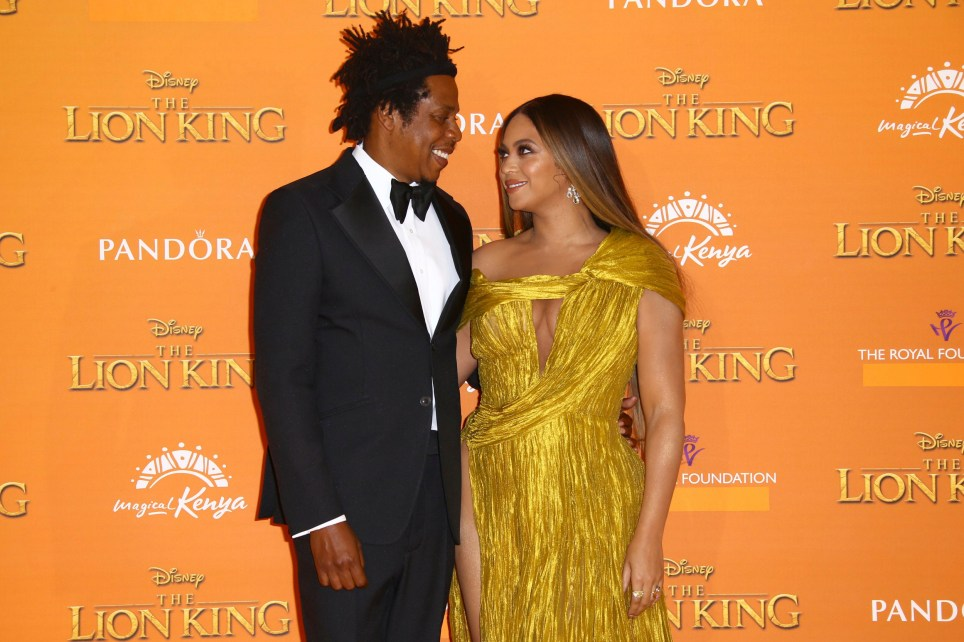 Singers Jay-Z, left, and Beyonce pose for photographers upon arrival at the 'Lion King' European premiere in central London, Sunday, July 14, 2019. (Photo by Joel C Ryan/Invision/AP)