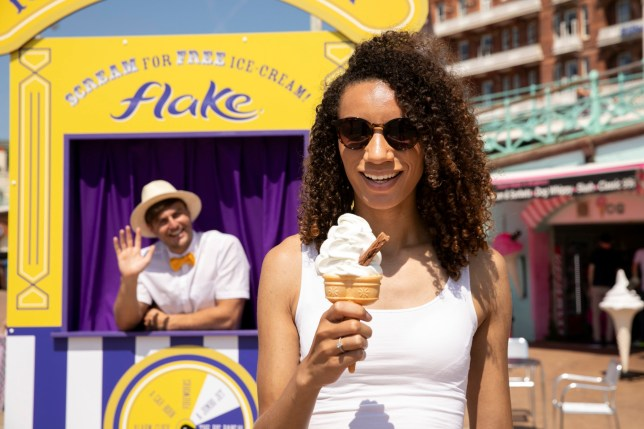 Woman holding a 99 flake ice cream in front of the iScream machine