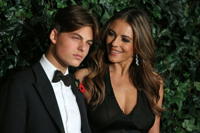 British actress Elizabeth Hurley (R) and her son Damian pose on the red carpet as they attend the 62nd London Evening Standard Theatre Awards 2016 in London on November 13, 2016. The Evening Standard Theatre Awards were established in 1955 to recognise outstanding achievement in London based Theatre, from actors to playwrights, designers to directors. / AFP / DANIEL LEAL-OLIVAS (Photo credit should read DANIEL LEAL-OLIVAS/AFP/Getty Images)