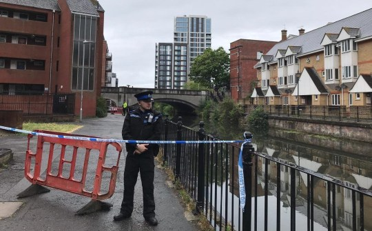 Woman's body pulled from river in front of commuters