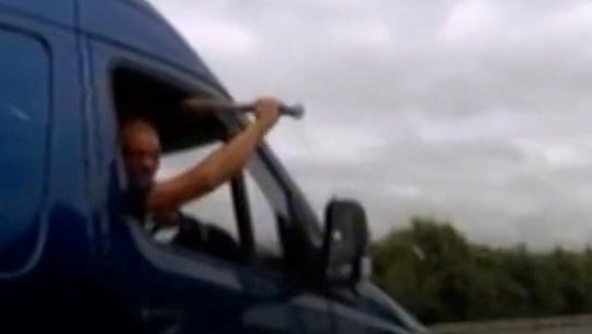 Video grab of labourer Joshua McKenzie, 36, brandishing a baseball bat at a driver after undertaking him on the M23 - yet McKenzie will avoid prison! See National News story NNbat. A man who brandished a baseball bat at a driver after undertaking him on the M23 has narrowly escaped prison. Labourer Joshua McKenzie, 36, undertook the Corsa in his Mercedes sprinter van, which was doing 70mph after tailgating him and flashing his lights. He then braked sharply and swerved between lanes before brandishing a baseball bat out of the window at the horrified Corsa driver who caught it on his dashcam. McKenzie, who admitted dangerous driving, will have to take an extended re-test if he wants to drive again.