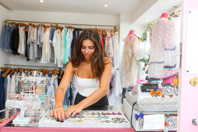 Francesca Allen working in her boutique
