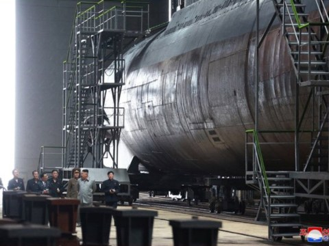 Kim Jong-Un tours 'newly built' submarine in 'ominous' pictures from North Korea