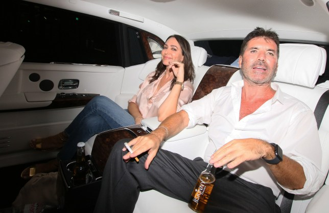 SIMON COWELL AND LAUREN SILVERMAN SEEN LEAVING BRITAINS GOT TALENT CHAMPION OF CHAMPIONS AT SSE ARENA IN LONDON. SIMON WAS SEEN SMOKING WITH A BOTTLE OF SKINNY BRANDS LAGER BETWEEN HIS LEGS. WEDNESDAY 24TH JULY 2019 - MAGICMOMENTSUK - 07753 30 30 77 ** EXCLUSIVE ALL ROUND PICS MIN FEE ??200 **