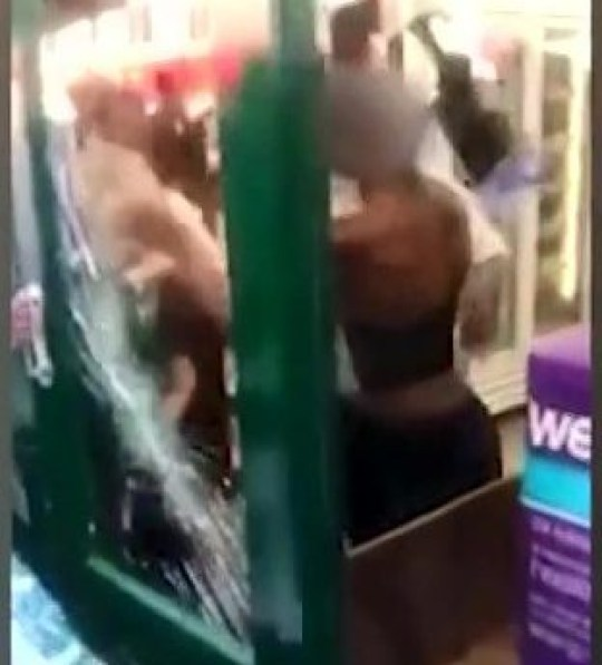 Shocking moment two female shoplifters beat Holland & Barrett worker after she caught them trying to steal in London Picture: DRN METROGRAB