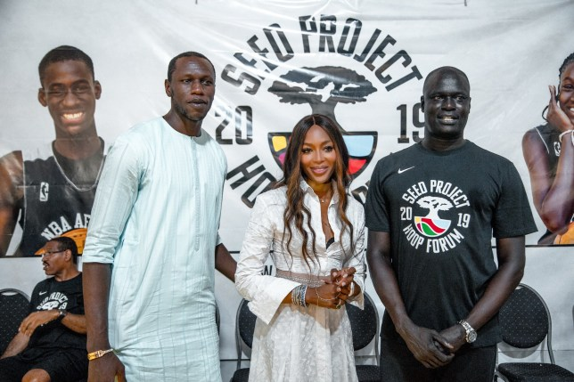 THIES, SENEGAL - JULY 24: In this handout image provided by APO Group, (L-R) Gorgui Dieng of Minnesota Timberwolves and Senegal, Naomi Campbell and Amadou Gallo Fall, Founder of SEED and NBA Vice President and President of the Basketball Africa League attend the Hoop Forum organized by SEED on July 24, 2019 in Thi??s, Senegal. (Photo by APO Group via Getty Images)