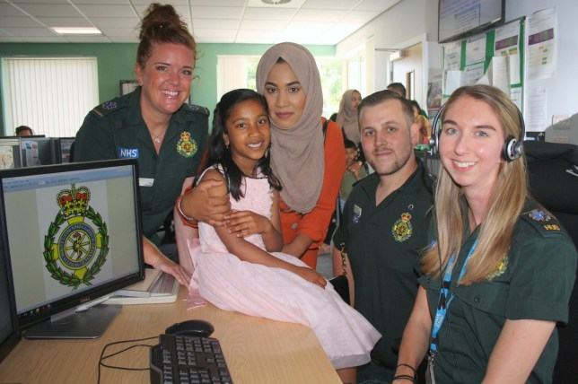 Inayah Yasmin, 7, called 999 when her mum Mariyam Yasmin (3rd right) had a severe allergic reaction to ice cream. See SWNS story SWBRice; A seven-year-old girl hailed hero for raising alarm when mum had allergic reaction to an ice cream in the heat wave. A 7-year-old girl has been formally commended for her brave 999 call when her mum had an allergic reaction to an ice cream. Mariyam Yasmin, 31, had an anaphylactic shock after consuming a Nestle Nobbly Bobbly ice lolly at home in the Moorlands area of Bath. She was struggling to breathe, shaking, and needed urgent medical help. Her daughter, Inayah, called 999 and told South Western Ambulance Service NHS Foundation Trust (SWASFT) call handler Lydia Gardiner what was wrong. Inayah remained calm, was able to give her mum a vital injection, and greeted crews when they arrived.