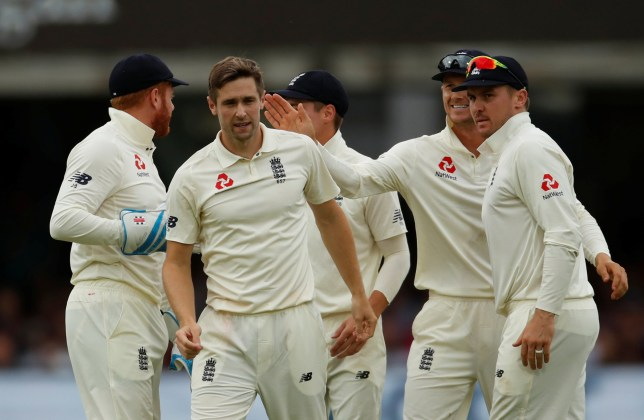 Cricket - Test Match - England v Ireland - Lord's Cricket Ground, London, Britain - July 26, 2019 England's Chris Woakes celebrates with team mates after taking the wicket of Ireland's Paul Stirling Action Images via Reuters/Andrew Boyers