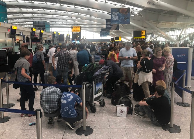 "Queues in Terminal 5 at Heathrow airport as the UK's biggest airport has apologised after extreme weather conditions across Europe caused flight cancellations and delays. PRESS ASSOCIATION Photo. Picture date: Friday July 26, 2019. Heathrow Airport is asking passengers to check with airlines before travelling, while Gatwick Airport issued the same advice, warning ""bad weather"" may delay flights. See PA story WEATHER Hot . Photo credit should read: Steve Parsons/PA Wire"