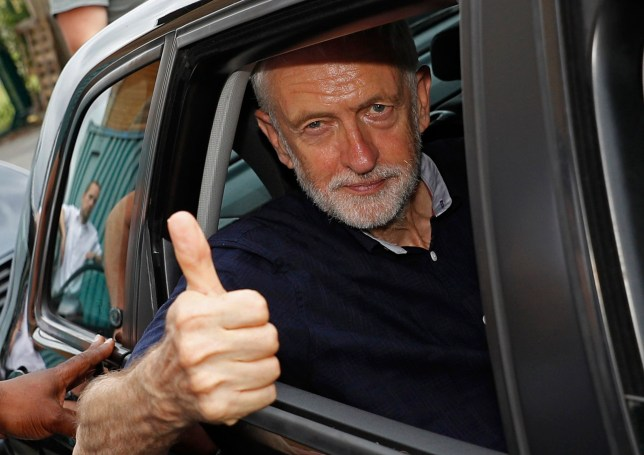 MANCHESTER, ENGLAND - JULY 26: Labour leader Jeremy Corbyn gestures as he leaves a rally after outlining plans for Labour's green industrial revolution in the North on July 26, 2019 in Manchester, England. (Photo by Darren Staples/Getty Images)