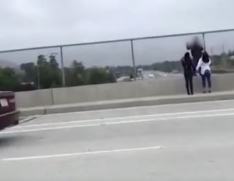 Moment two kind women talk suicidal man out of jumping off busy road bridge