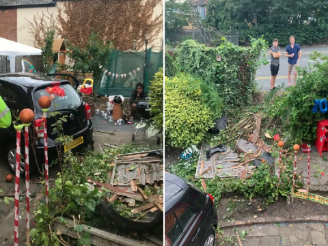 Car crashes through fence into garden party missing children by inches