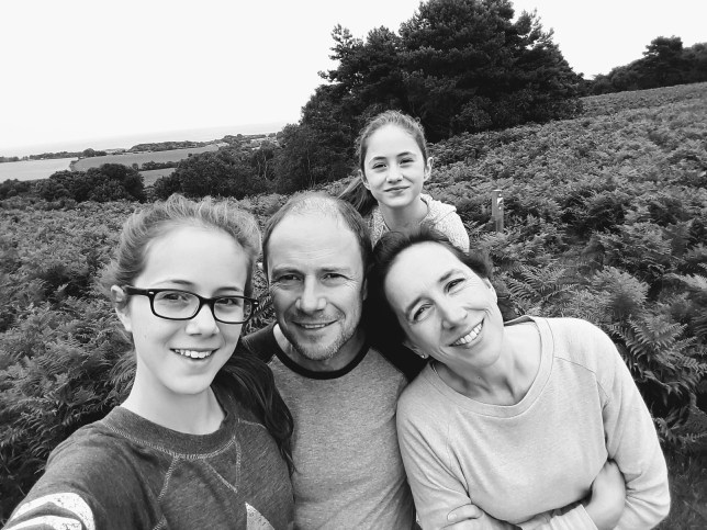 Phil with his wife and two daughters