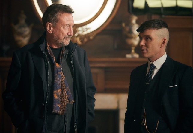 Steven Knight (writer/creator) and Cillian Murphy (Tommy Shelby) on the set of Peaky Blinders   Series 5 (BBC One)   Episode 01   behind-the-scenes Photographer: Robert Viglasky © Caryn Mandabach Productions Ltd. 2019