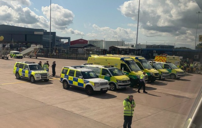 Police surrounded the plane when it landed at Manchester Airport (Picture: Twitter/@NicholasVisuals)