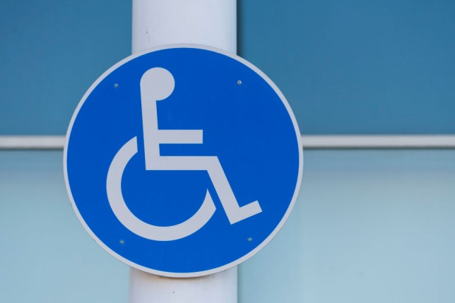 A blue disabled parking sign in the UK