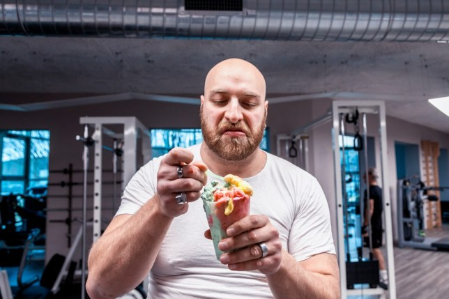 Man eating ice cream at the gym