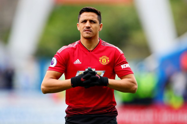 Alexis Sanchez playing for Manchester United against Huddersfield Town