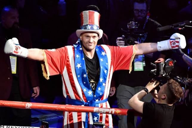 Tyson Fury enters the ring ahead of his fight with Tom Schwartz