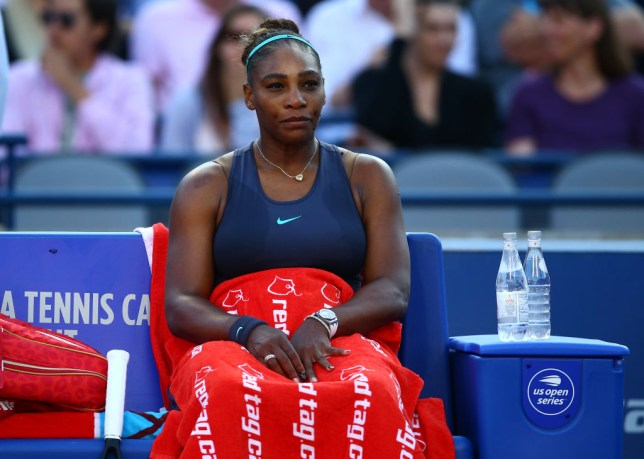 Serena Williams sits looking gloomy at the Rogers Cup