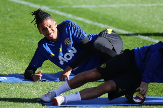 Chris Smalling stretches during Manchester United's pre-season
