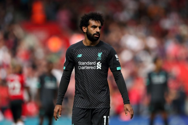 Mohammed Salah looks on during a match for Liverpool