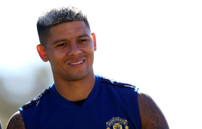 Marcos Rojo looks on during Manchester United training