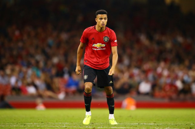 Mason Greenwood looks on while playing for Manchester United