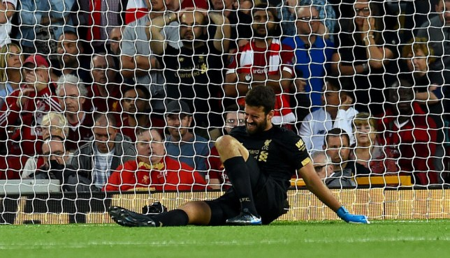 Alisson went down injured in the first half against Norwich