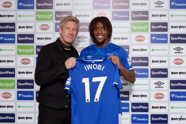 Alex Iwobi poses with an Everton shirt after joining from Arsenal