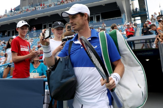 Andy Murray films his Cincinnati Masters walkout on his phone as he prepares to take on Richard Gasquet