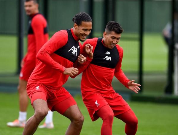Virgil Van Dijk battles against Roberto Firmino during Liverpool training