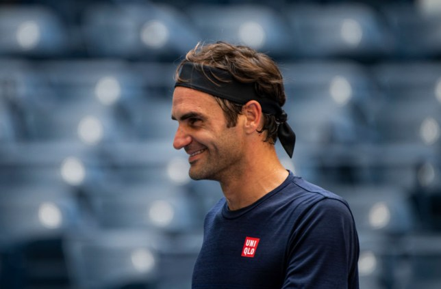 Roger Federer smiles as he practises at the US Open