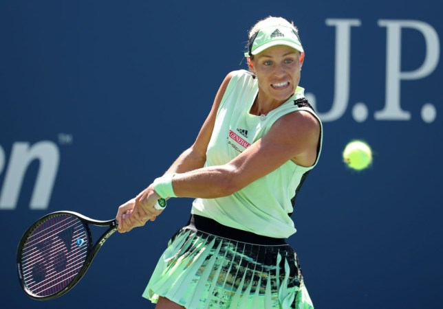Angelique Kerber hits a backhand during her US Open defeat