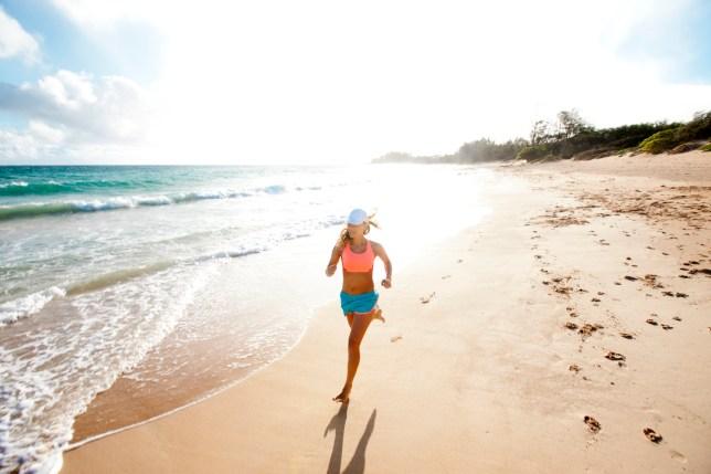 Female running on a sandy beach