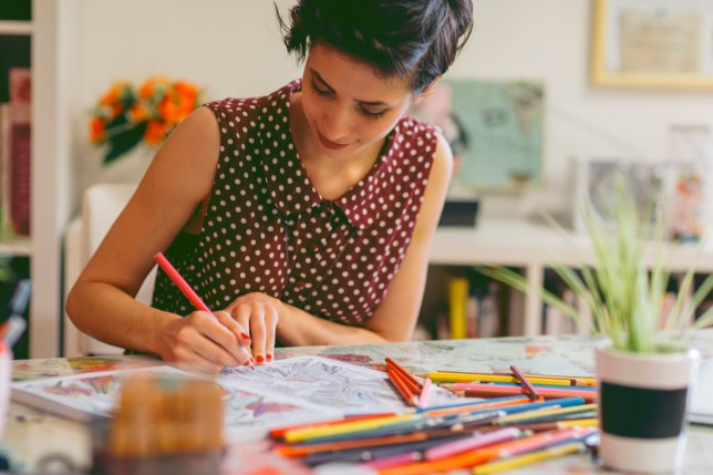 woman colouring in a book