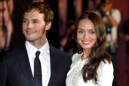 Sam Claflin and Laura Haddock pose together on the red carpet