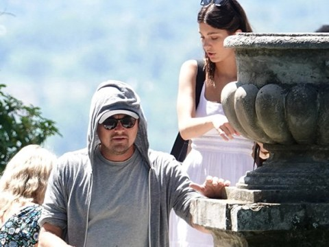 Leonardo DiCaprio and Camila Morrone put on cosy display as they cuddle for photos on Euro trip