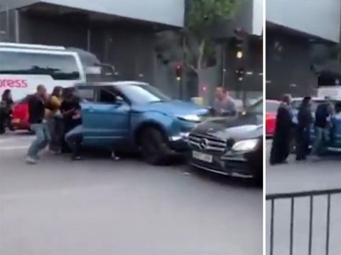 Shocking moment woman crushed between two cars in 'road rage incident'