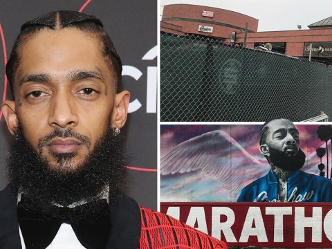 Nipsey Hussle fans prevented from staging birthday memorial at LA clothing store by huge fence