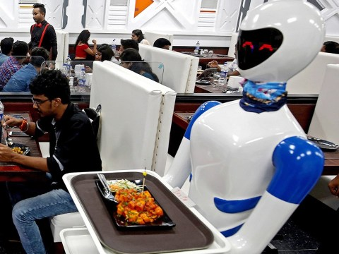 Restaurant where waiters have been replaced with female robots