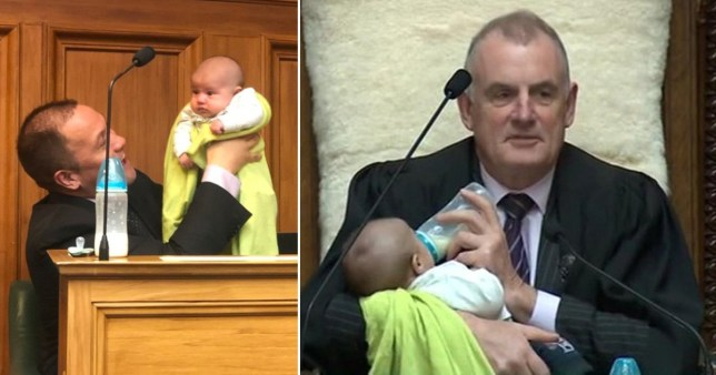 New Zealand speaker Trevor Mallard holds MP Tamati Coffey's baby during debate