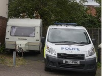 Mum arrested after 10-year-old son 'found dead in caravan'