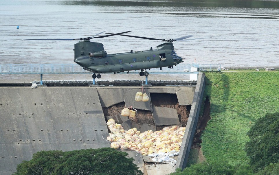PABest An RAF Chinook helicopter flies in sandbags to help repair the dam at Toddbrook reservoir near the village of Whaley Bridge in Derbyshire after it was damaged by heavy rainfall. PRESS ASSOCIATION Photo. Picture date: Friday August 2, 2019. See PA story WEATHER Rain. Photo credit should read: Danny Lawson/PA Wire